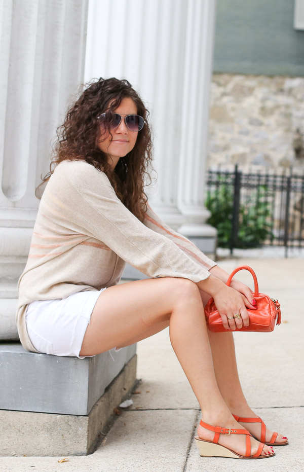 light summer sweater with white denim shorts and orange shoes and bag
