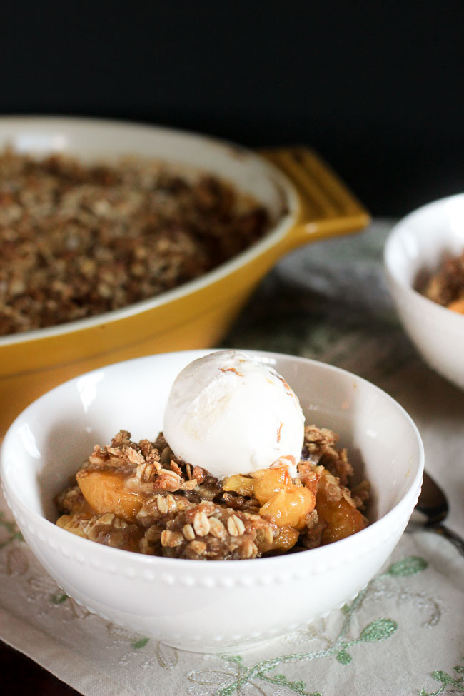 Traditional and simple peach crisp with oat streusel topping
