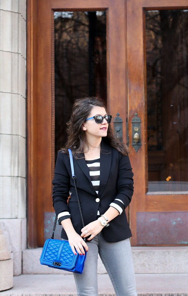 classic black blazer with a black and white striped crop top, gray denim and a pop of cobalt
