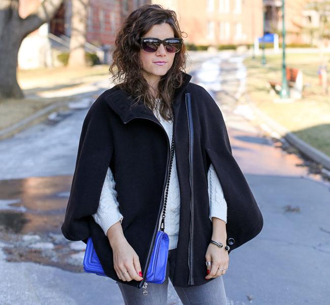 a black winter cape with the Rebecca Minkoff Love cross body in ultraviolet