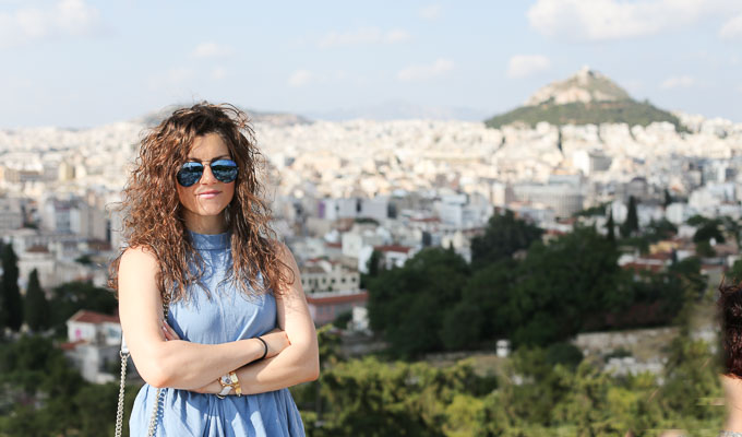 sightseeing Athens - white jeans, Free People top and white slides